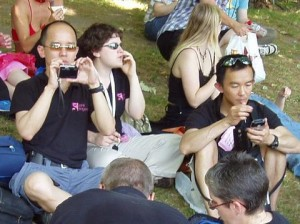 Some Pink Singers playing with their gadgets