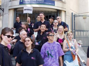 A group of Pink Singers outside Charing Cross station