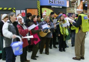 Pinkies carolling at Victoria Station in 2009