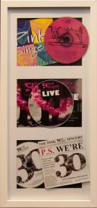 Framed copies of all three Pink Singers CDs