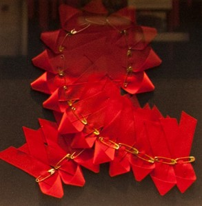 Photograph of red ribbons together making up one large red ribbon