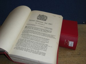 Photograph of a law book opened at the Sexual Offences Act 1967 text